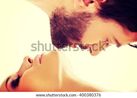 Attracive men kissing woman's neck. - stock photo