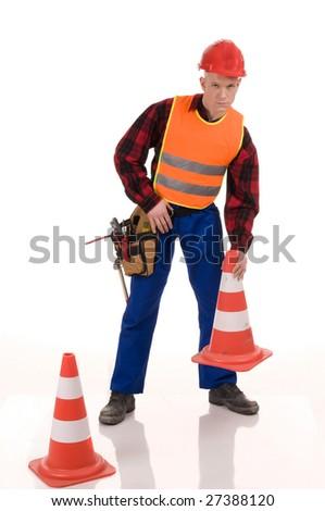 Attractiev road worker placing orange posts - stock photo
