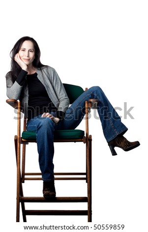 Attractive actress in her chair, isolated image