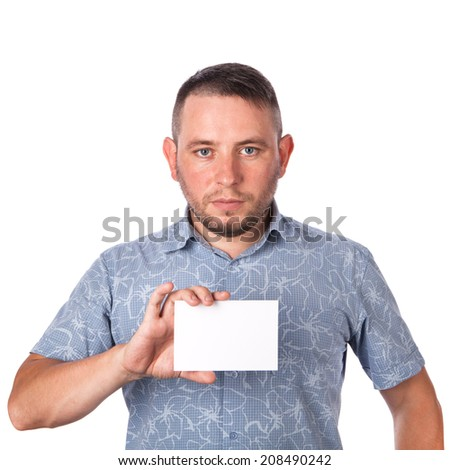 Attractive adult man with stubble in summer shirt in his hands holding a white sheet with space for advertising text on an isolated white background - stock photo