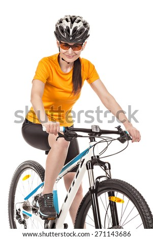 Attractive adult woman cyclist isolated on white background, studio shot. - stock photo