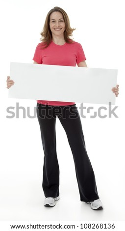 Attractive adult woman standing, holding blank sign, isolated on white.
