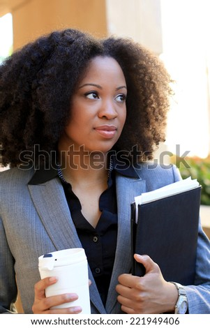 Attractive African American Business Professional Business Woman Holding Folder and Coffee Cup - stock photo
