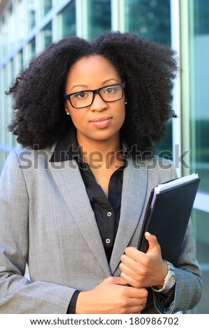 Attractive African American Professional Business Professional Wearing Black Glasses and Holding Folder - stock photo