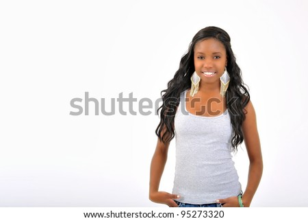 Attractive African-American young woman in grey tank top and denim - model in studio - hand in pocket - horizontally framed
