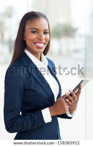 attractive african business executive working on tablet pc in office - stock photo