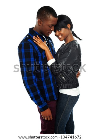 Attractive african couple posing together on white background