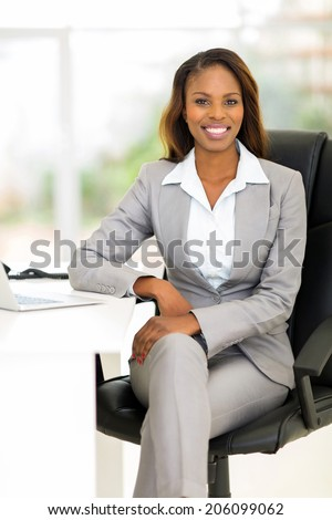 attractive african female business executive in modern office - stock photo