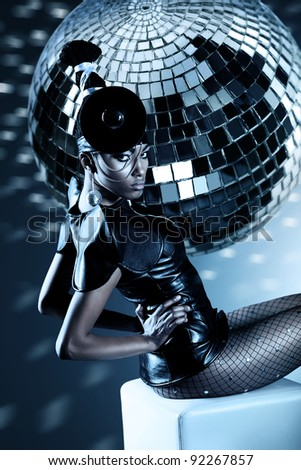 Attractive african woman with disco ball - stock photo