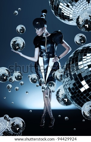 Attractive african woman with disco ball in her right hand - stock photo