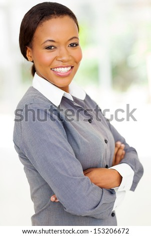attractive afro american woman with arms folded looking at the camera - stock photo