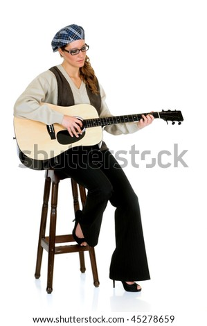 Attractive alternative dressed music performer, guitar player.  Studio, white background