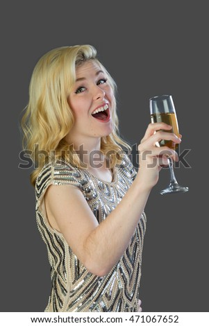 Attractive and glamourous woman with a glass of champagne