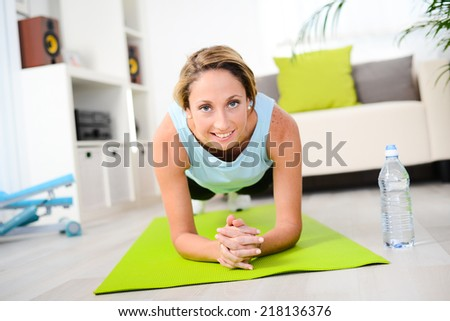 attractive and healthy lifestyle young woman doing fitness exercises and workout at home - stock photo