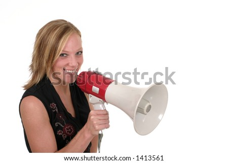 Attractive and smiling young executive business woman making her point really clear with the aid of a megaphone.