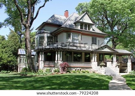 Attractive architecture and front porch on this upscale home in Oak Park, Illinois, where Frank Lloyd Wright worked - stock photo