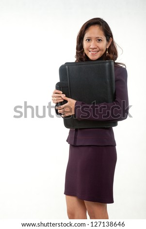 Attractive asian american businesswoman carrying briefcase - stock photo