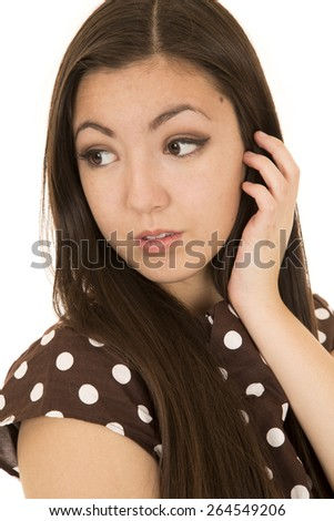 Attractive Asian American woman portrait glancing backwards - stock photo