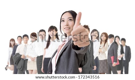 Attractive Asian business woman give you an excellent sign and stand in front of her team.