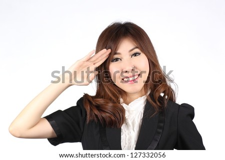 Attractive Asian business woman saluting /over white background - stock photo