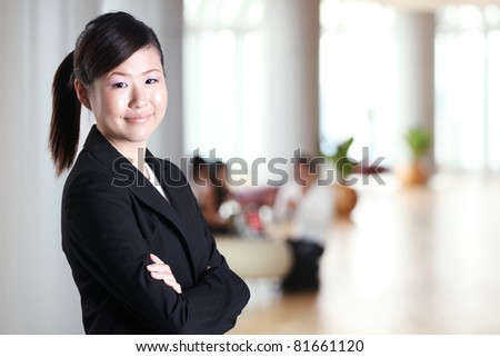 Attractive Asian business woman shot in studio