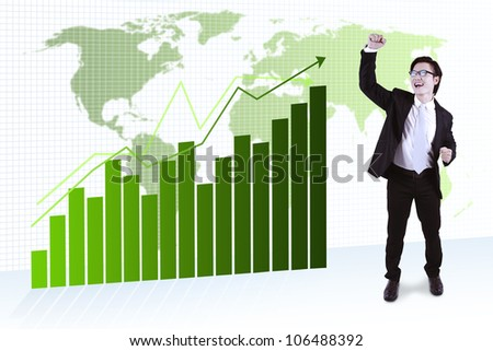 Attractive asian businessman celebrating his success. shot over global business chart