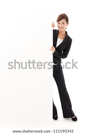 attractive asian businesswoman with blank whiteboard
