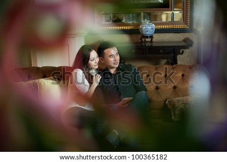 Attractive Asian Couple in Lounge Area