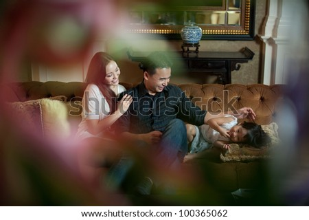 Attractive Asian Family in Lounge Area - stock photo