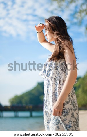 Attractive Asian Female looking out into the sea - stock photo