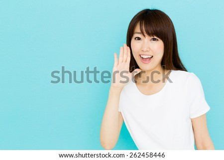 attractive asian nurse on blue background - stock photo