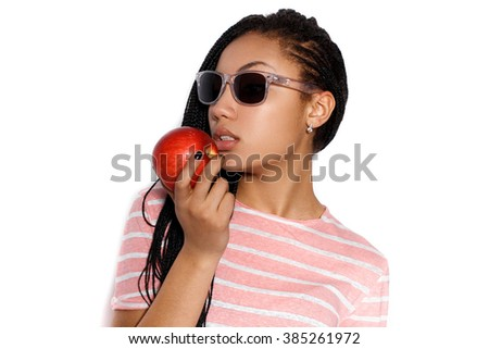 Attractive asian posing in the studio on a white background, holding an apple in his hand. - stock photo