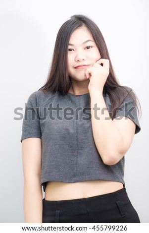 Attractive asian sexy woman standing on white background show hand sign