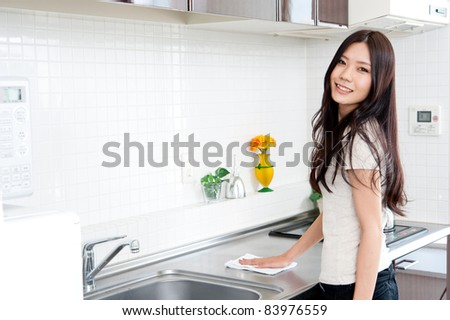 attractive asian woman cleaning to sink