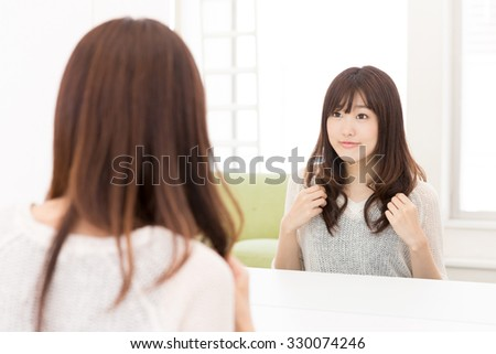 attractive asian woman haircare image - stock photo