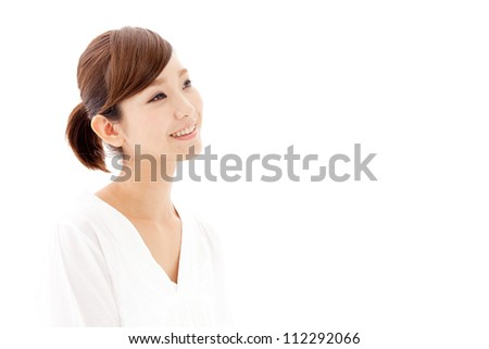 attractive asian woman looking on white background - stock photo