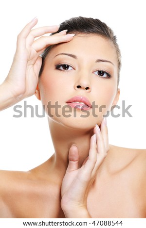 Attractive asian woman pampering her  face by beauty slender fingers