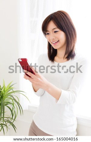 attractive asian woman relaxing in the room