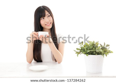 attractive asian woman relaxing on white background - stock photo