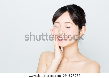 attractive asian woman skincare image on white background - stock photo