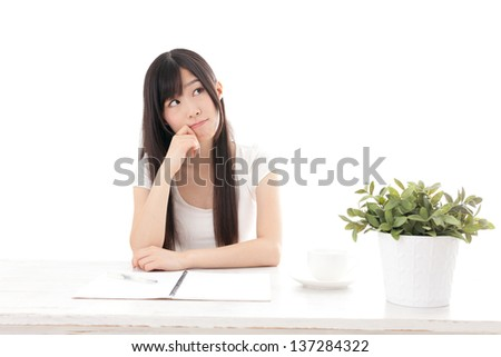 attractive asian woman studying on white background - stock photo