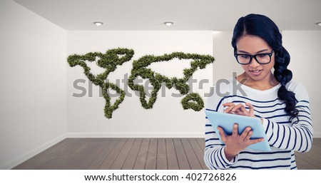 Attractive Asian woman using tablet against digitally generated room with stairs - stock photo