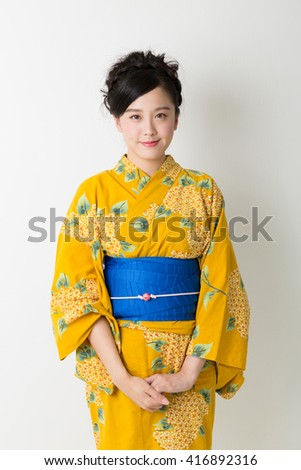 "attractive asian woman wearing traditional Japanese casual summer kimono called ""Yukata"". - stock photo"
