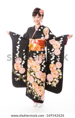 attractive asian woman wearing traditional japanese kimono on white background - stock photo