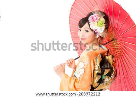 attractive asian woman wearing traditional kimono on white background - stock photo