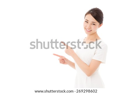 attractive asian woman wearing white clothes showing on white background
