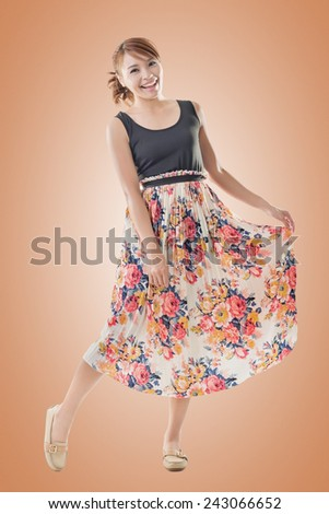 Attractive Asian woman with maxi dresses, full length isolated. - stock photo