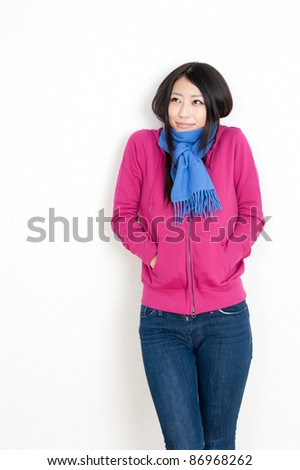 attractive asian woman with muffler - stock photo