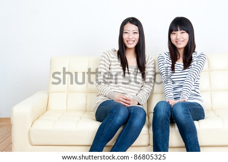 attractive asian women relaxing in the living room - stock photo