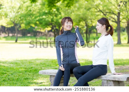 attractive asian women relaxing in the park